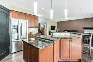 Photo 11: 157 Springbluff Boulevard SW in Calgary: Springbank Hill Detached for sale : MLS®# A1129724