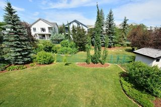 Photo 49: 104 GLENEAGLES Landing: Cochrane House for sale : MLS®# C4127159