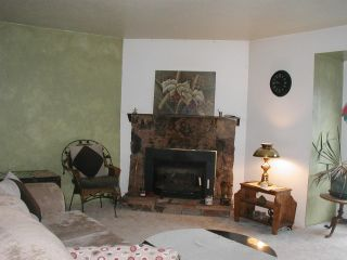 """Photo 1: 4 822 GIBSONS WAY Way in Gibsons: Gibsons & Area Townhouse for sale in """"The Manse"""" (Sunshine Coast)  : MLS®# R2021310"""