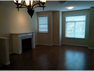 """Photo 3: 5 8655 159TH Street in Surrey: Fleetwood Tynehead Townhouse for sale in """"SPRINGFIELD COURT"""" : MLS®# F1406166"""