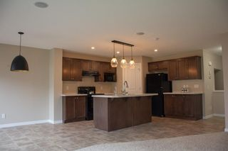 Photo 7: 14 HILLCREST Street SW: Airdrie Detached for sale : MLS®# A1031272