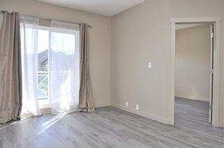 Photo 5: 2101 5605 HENWOOD Street SW in Calgary: Garrison Green Apartment for sale : MLS®# C4204085