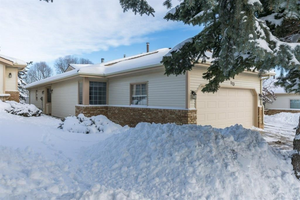 Main Photo: 113 Shawnee Rise SW in Calgary: Shawnee Slopes Semi Detached for sale : MLS®# A1068673
