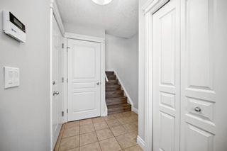 Photo 23: 5 Cougar Ridge Mews SW in Calgary: Cougar Ridge Row/Townhouse for sale : MLS®# A1105171