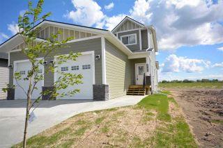 Photo 1: 8203 79A Street in Fort St. John: Fort St. John - City SE 1/2 Duplex for sale (Fort St. John (Zone 60))  : MLS®# R2487647