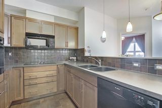 Photo 6: 213 26 VAL GARDENA View SW in Calgary: Springbank Hill Apartment for sale : MLS®# A1095989