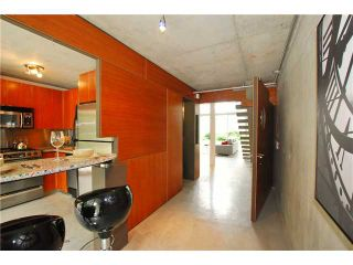 """Photo 6: 203 1540 W 2ND Avenue in Vancouver: False Creek Condo for sale in """"WATERFALL BUILDING"""" (Vancouver West)  : MLS®# V954778"""
