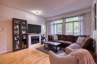 "Photo 3: 10180 153 Street in Surrey: Guildford Condo for sale in ""Charlton Park"" (North Surrey)  : MLS®# R2388907"