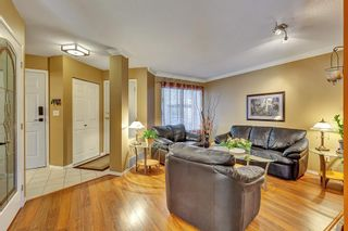 """Photo 4: 506 13900 HYLAND Road in Surrey: East Newton Townhouse for sale in """"HYLAND GROVE"""" : MLS®# R2595729"""