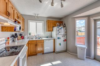 Photo 5: 38 Coverdale Way NE in Calgary: Coventry Hills Detached for sale : MLS®# A1120881