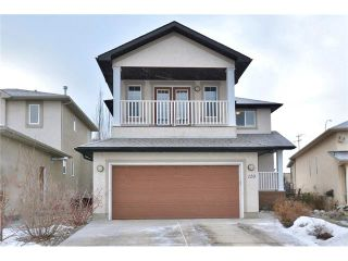 Photo 1: 120 SUNTERRA Heights: Cochrane House for sale : MLS®# C4103132