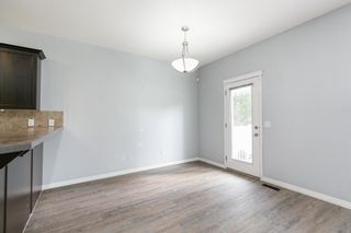 Photo 11: 58 Arbours Circle NW: Langdon Row/Townhouse for sale : MLS®# A1137898