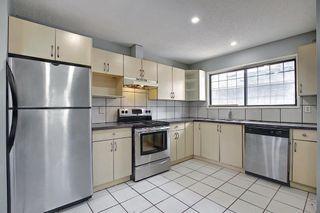 Photo 6: 455 Falconridge Crescent NE in Calgary: Falconridge Detached for sale : MLS®# A1103477
