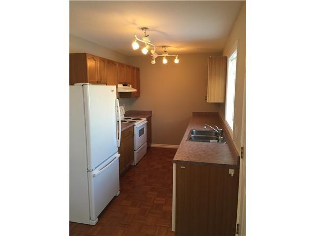 Photo 2: Photos: 10204 103RD Avenue in Fort St. John: Fort St. John - City NW 1/2 Duplex for sale (Fort St. John (Zone 60))  : MLS®# N241739