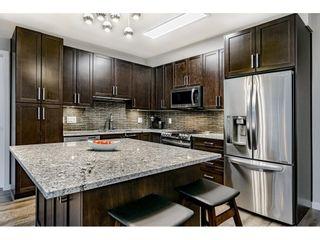 "Photo 4: 204 6470 194 Street in Surrey: Clayton Condo for sale in ""WATERSTONE-ESPLANADE"" (Cloverdale)  : MLS®# R2427138"