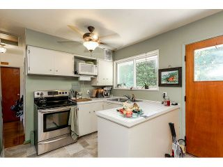 Photo 7: 714 IVY Avenue in Coquitlam: Coquitlam West House for sale : MLS®# V1131997