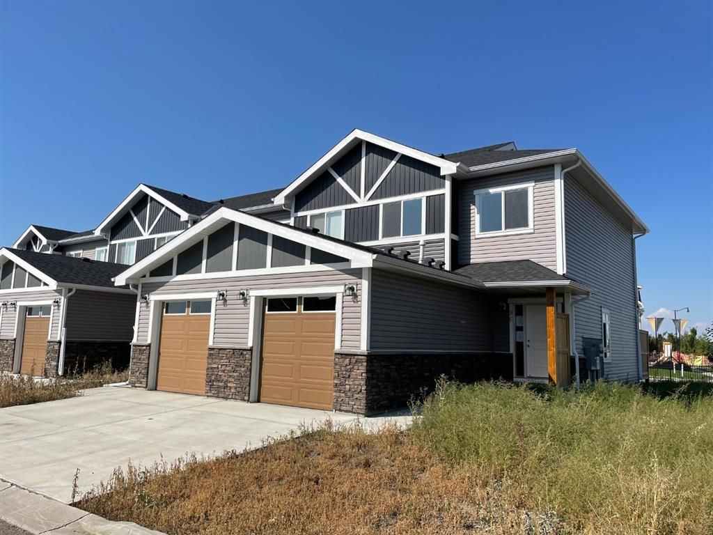Main Photo: 96 351 Monteith Drive SE: High River Row/Townhouse for sale : MLS®# A1143510