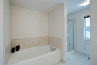 Photo 23: 102 Crestbrook Hill SW in Calgary: Crestmont Detached for sale : MLS®# A1100140