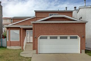 Photo 1: 93 Sidon Crescent SW in Calgary: Signal Hill Detached for sale : MLS®# A1150956
