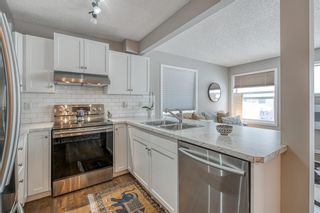 Photo 7: 313 Country Village Cape NE in Calgary: Country Hills Village Row/Townhouse for sale : MLS®# A1064695