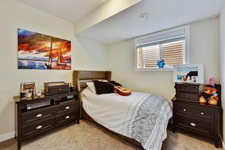 Photo 39: 4 EMBERSIDE Glen: Cochrane Detached for sale : MLS®# A1009934