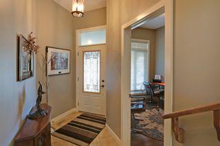 Photo 2: 215 Sunset Square in Cochrane: Duplex for sale : MLS®# C4007845