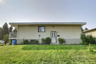 Photo 2: 7011 HUNTERVILLE Road NW in Calgary: Huntington Hills Semi Detached for sale : MLS®# A1035276