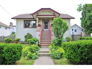 Photo 1: 980 E 24TH Avenue in Vancouver: Fraser VE House for sale (Vancouver East)  : MLS®# V1071131