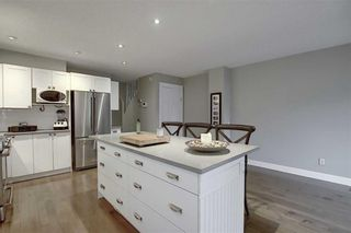 Photo 9: 231 COACHWAY Road SW in Calgary: Coach Hill Detached for sale : MLS®# C4305633