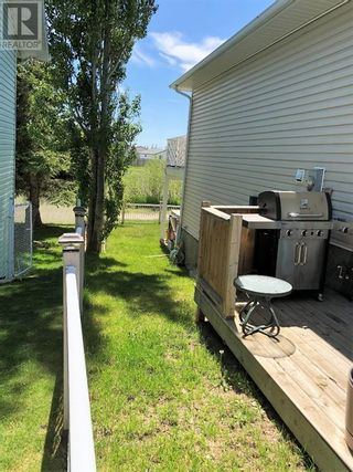 Photo 28: 907 2 Avenue  W in Brooks: House for sale : MLS®# A1115506