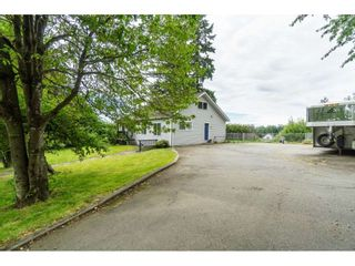 """Photo 2: 3003 208 Street in Langley: Brookswood Langley House for sale in """"Brookswood Fernridge"""" : MLS®# R2557917"""