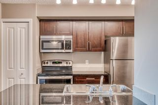Photo 4: 6205 403 Mackenzie Way SW: Airdrie Apartment for sale : MLS®# A1145558