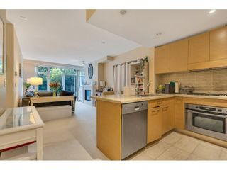 """Photo 2: 102 6015 IONA Drive in Vancouver: University VW Condo for sale in """"Chancellor House"""" (Vancouver West)  : MLS®# R2618158"""