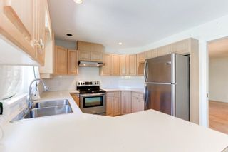 """Photo 9: 129 13888 70TH Avenue in Surrey: East Newton Townhouse for sale in """"Chelsea Gardens"""" : MLS®# R2594472"""