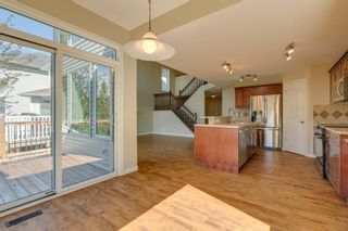Photo 9: 144 Tuscany Meadows Heath NW in Calgary: Tuscany Detached for sale : MLS®# A1030703