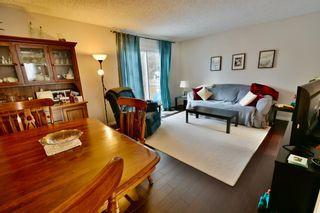 Photo 7: 108 4810 40 Avenue SW in Calgary: Glamorgan Row/Townhouse for sale : MLS®# A1060323