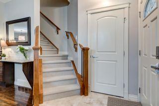 Photo 2: 1 223 17 Avenue NE in Calgary: Tuxedo Park Row/Townhouse for sale : MLS®# A1119296
