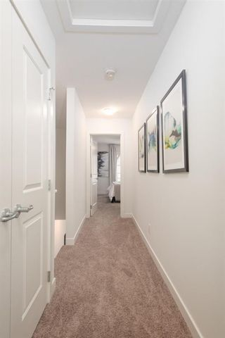 Photo 12: 25 Evanscrest Park NW in Calgary: Evanston Row/Townhouse for sale : MLS®# A1067562