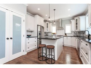 """Photo 15: 7089 179 Street in Surrey: Cloverdale BC House for sale in """"Provinceton"""" (Cloverdale)  : MLS®# R2492815"""