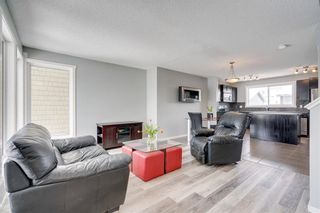 Photo 2: 254 WALDEN Gate SE in Calgary: Walden Row/Townhouse for sale : MLS®# C4305539