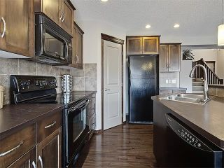 Photo 5: 681 CRANSTON Drive SE in Calgary: Cranston House for sale : MLS®# C4110392