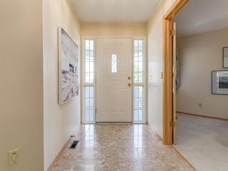 Photo 2: 25 PUMP HILL Landing SW in Calgary: Pump Hill Semi Detached for sale : MLS®# A1013787