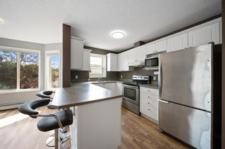 Photo 3: 202 9 Country Village Bay NE in Calgary: Country Hills Village Apartment for sale : MLS®# A1135669