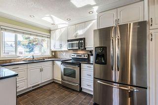 Photo 9: 11 Hogarth Crescent SW in Calgary: Haysboro Detached for sale : MLS®# A1150349