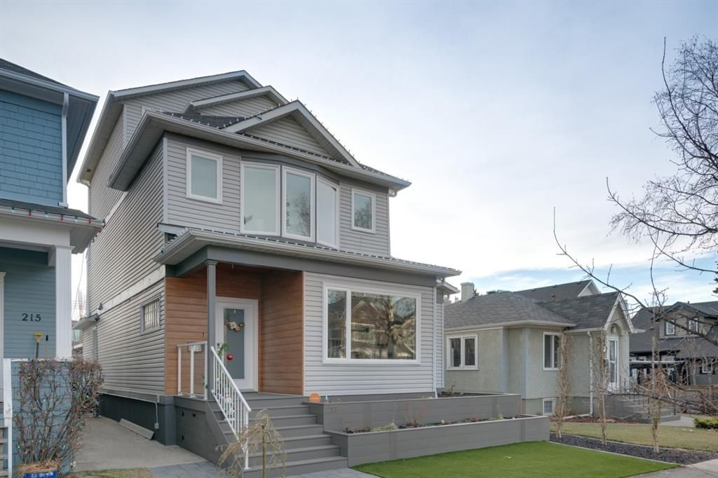 Perched high on the ridge in desirable Crescent Heights this significantly renovated property enjoys a 37.5 ft South backing and >3700 sq ft of developed living space.