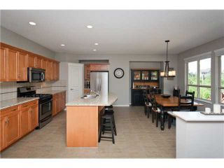 """Photo 3: 110 HAWTHORN Drive in Port Moody: Heritage Woods PM House for sale in """"EVERGREEN HEIGHTS"""" : MLS®# V962426"""