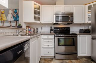"Photo 6: 413 14377 103 Avenue in Surrey: Whalley Condo for sale in ""Claridge Court"" (North Surrey)  : MLS®# R2189237"