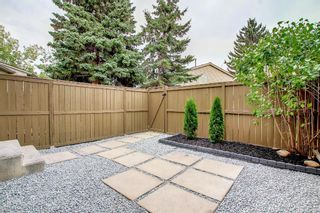 Photo 34: 77 123 Queensland Drive SE in Calgary: Queensland Row/Townhouse for sale : MLS®# A1145434