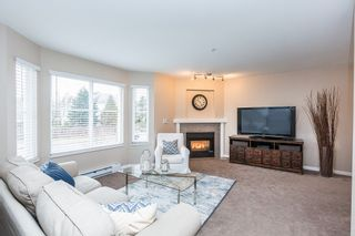 """Photo 1: 6 2458 PITT RIVER Road in Port Coquitlam: Mary Hill Townhouse for sale in """"SHAUGHNESSY MEWS"""" : MLS®# R2143151"""