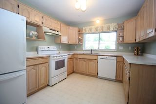 """Photo 5: 235 2451 GLADWIN Road in Abbotsford: Abbotsford West Condo for sale in """"Centennial Court"""" : MLS®# R2403099"""